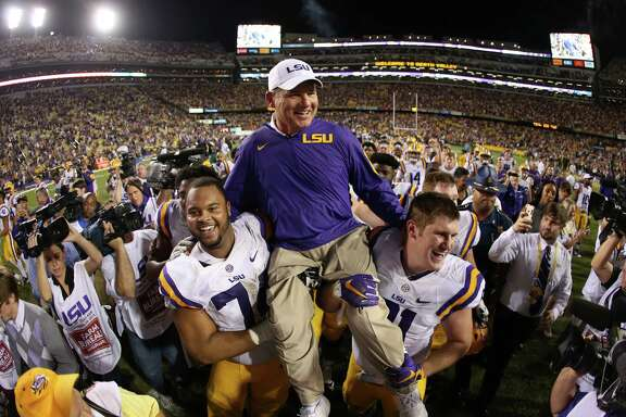 A day many thought would end with Les Miles down and out saw the LSU coach riding high.