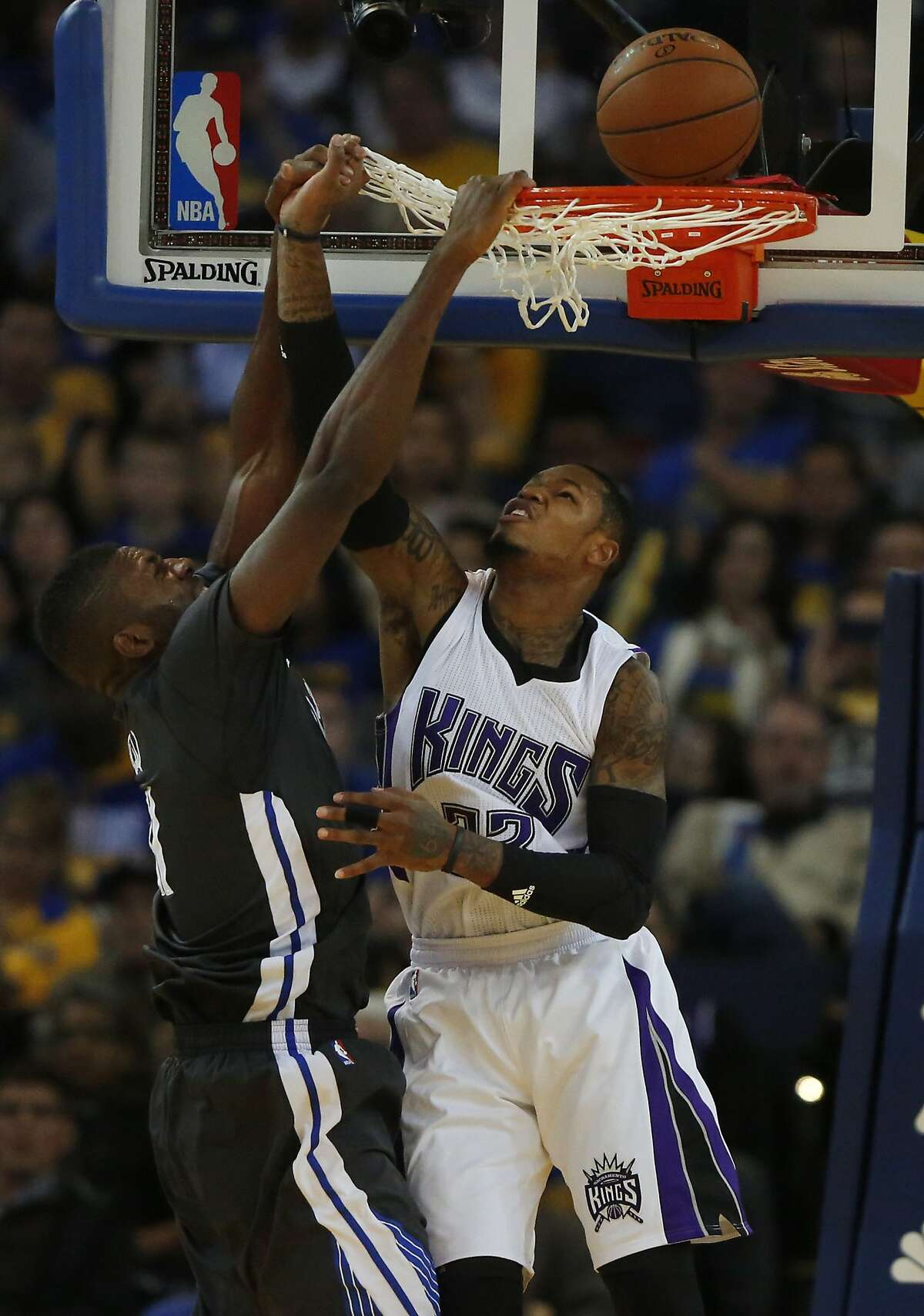 Warriors' Festus Ezeli attempts a slam dunk as the Kings' Ben McLemore attempts a block during the Golden State Warriors vs. the Sacramento Kings game in Oracle Arena Nov. 28, 2015 in Oakland, Calif.
