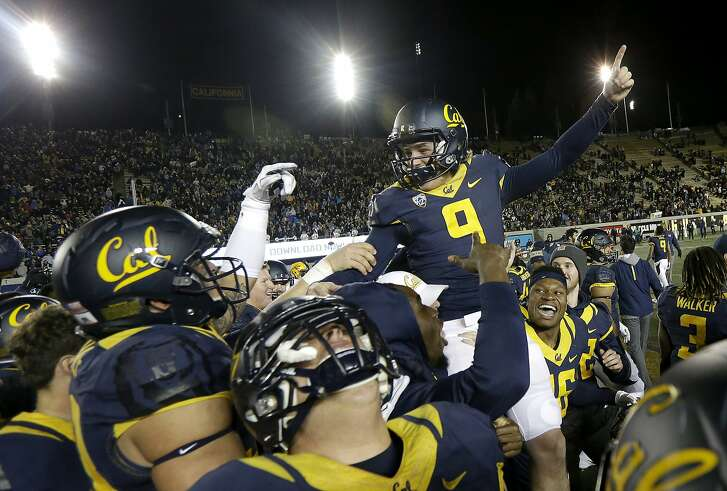 California place kicker Matt Anderson (9) is lifted by teammates after kicking the game-winning field goal against Arizona State during the second half of an NCAA college football game in Berkeley, Calif., Saturday, Nov. 28, 2015. California won 48-46. (AP Photo/Jeff Chiu)