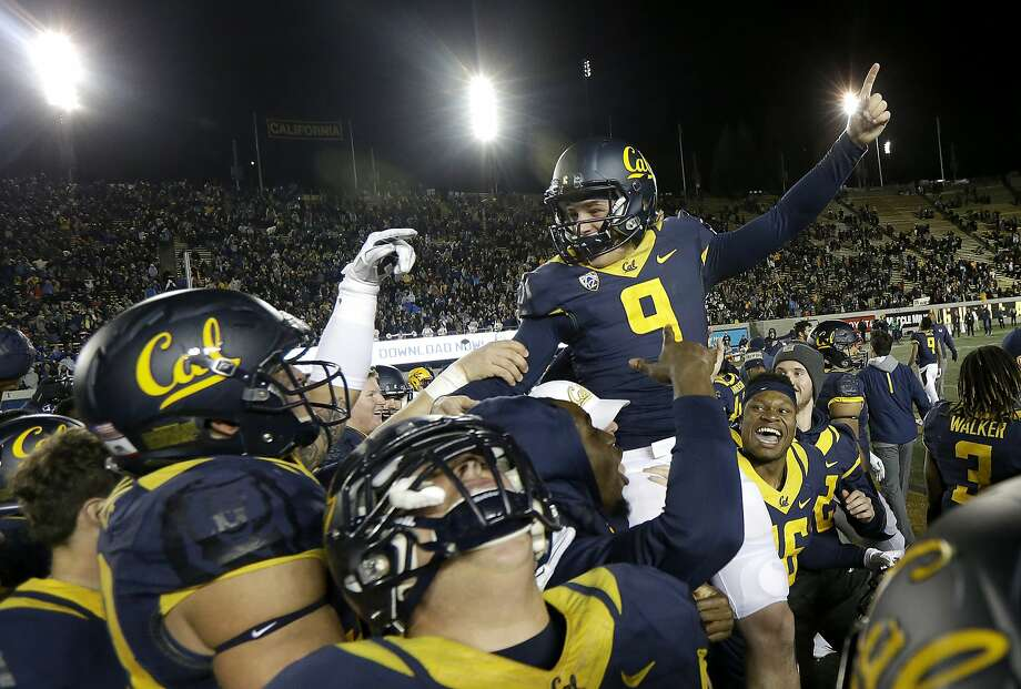 California place kicker Matt Anderson (9) is lifted by teammates after kicking the game-winning field goal against Arizona State during the second half of an NCAA college football game in Berkeley, Calif., Saturday, Nov. 28, 2015. California won 48-46. (AP Photo/Jeff Chiu) Photo: Jeff Chiu, Associated Press