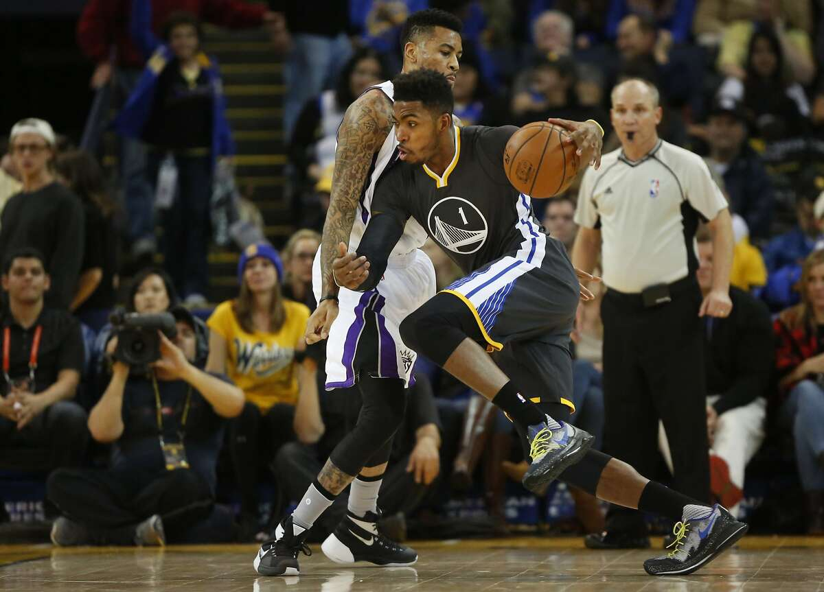 The Warriors' Jason Thompson, right, drives the ball into the Kings' Eric Moreland towards the basket during the Golden State Warriors vs. the Sacramento Kings game in Oracle Arena Nov. 28, 2015 in Oakland, Calif.