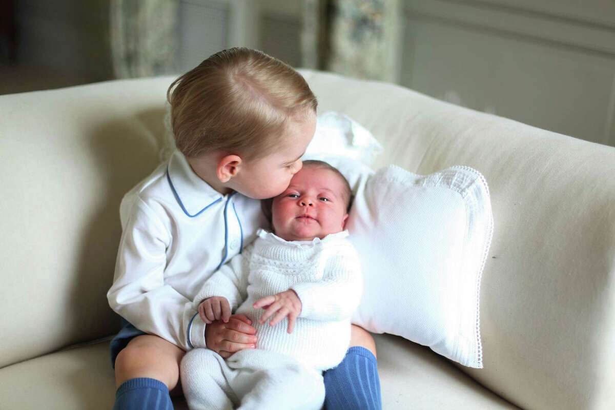 TOPSHOTS A handout picture released by Kensington Palace and taken by Britain's Catherine, Duchess of Cambridge in May, 2015 shows Prince George of Cambridge (L) and Princess Charlotte of Cambridge (R) at Anmer Hall in Norfolk, eastern England. The Duke of Duchess of Cambridge released four official photographs taken by the Duchess of Prince George and one-month-old Princess Charlotte together at their country retreat in Sandringham. RESTRICTED TO EDITORIAL USE - MANDATORY CREDIT