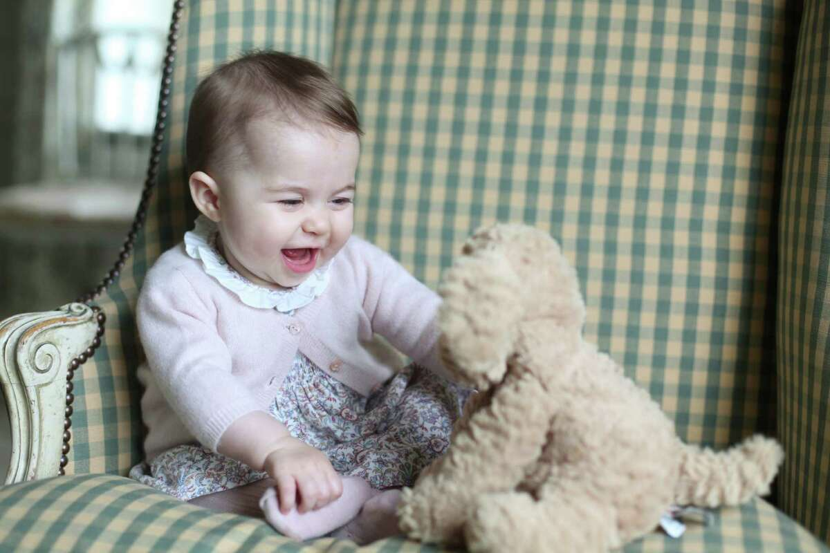 In this undated photo released Sunday Nov. 29, 2015, by Britain's Duke and Duchess of Cambridge, showing Princess Charlotte with her cuddly toy dog, at Anmer Hall in Sandringham, England. Princess Charlotte was born May 2, 2015, and the photo was taken by her mother, Kate Duchess of Cambridge, during November 2015. (Duchess of Cambridge via AP) ORG XMIT: LON809