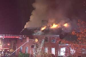 Fire heavily damages historic Monroe house - Photo