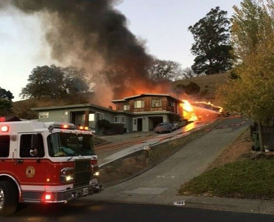 A two-alarm fire burned a home and part of a hillside Saturday evening in Novato, causing an estimated $160,000 in damage. Photo: Novato Fire District
