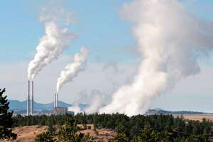 FILE - This Nov. 18, 2008 file photo shows the coal-fired power plant in Colstrip in southeastern Montana. Possible pathways are starting to emerge on how to reach the carbon-cutting goals set for Montana by 2030. The state faces the nation�s most stringent cuts under President Barack Obama�s climate change plan to reduce emissions nationwide 32 percent. A recently released study funded by NorthWestern Energy envisions closing Colstrip, the second-largest coal-fired plant west of the Mississippi River.