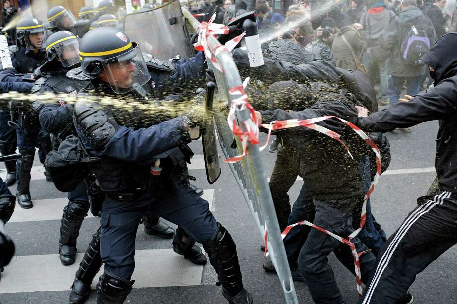 Policemen fight with activists during a protest ahead of the 2015 Paris Climate Conference at the place de la Republique, in Paris, Sunday, Nov. 29, 2015. More than 140 world leaders are gathering around Paris for high-stakes climate talks that start Monday, and activists are holding marches and protests around the world to urge them to reach a strong agreement to slow global warming. Photo: Laurent Cipriani, AP / AP