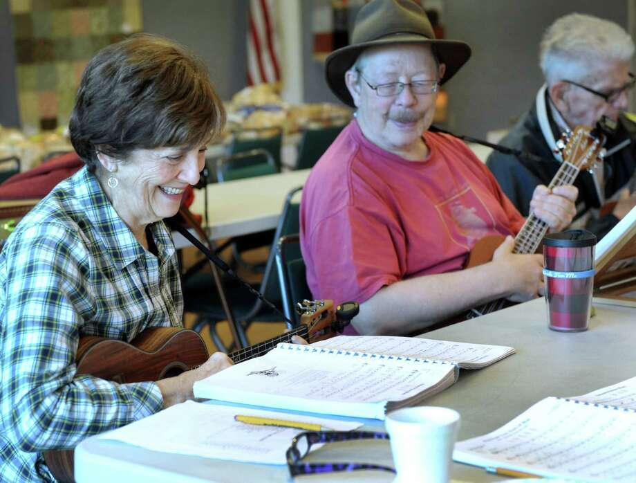 From left, Janet Kahn, 73,  Carl Knobloch, 64, and Bart Mahon, 87, of Danbury, play together during a weekly meeting of The Hat City Uke Band at Elmwood Hall, the Danbury Senior Center, Friday, Nov. 20, 2015. Photo: Carol Kaliff / Hearst Connecticut Media / The News-Times