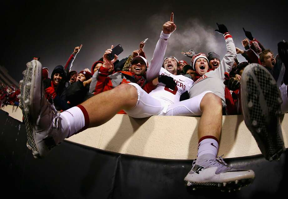 STILLWATER, OK - NOVEMBER 28:  Baker Mayfield #6 of the Oklahoma Sooners celebrates with fans after beating the Oklahoma State Cowboys 58-23 at Boone Pickens Stadium on November 28, 2015 in Stillwater, Oklahoma.  (Photo by Tom Pennington/Getty Images) Photo: Tom Pennington, Getty Images