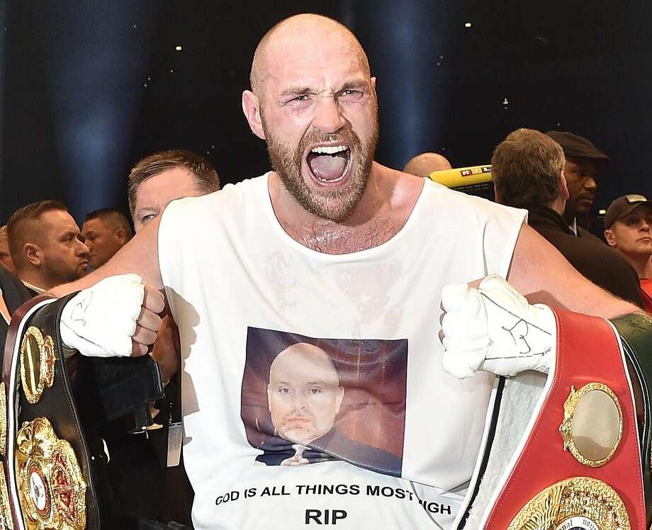 Britain's Tyson Fury won heavyweight belts from the WBA, IBF, WBO and IBO organizations on Saturday night. Photo: Martin Meissner, Associated Press