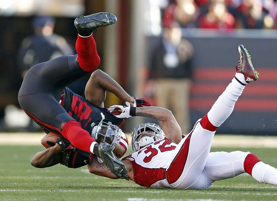 San Francisco 49ers' Anquan Boldin is tackled by Arizona Cardinals' Tyrann Mathieu in 2nd quarter during NFL game at Levi's Stadium in Santa Clara, Calif., on Sunday, November 29, 2015. Photo: Scott Strazzante, The Chronicle
