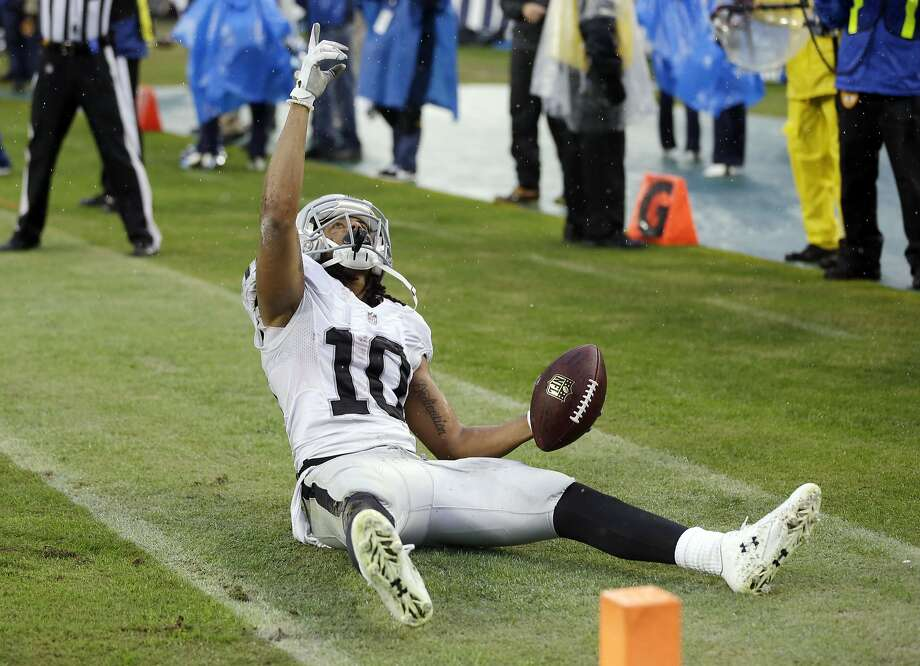 Oakland Raiders wide receiver Seth Roberts (10) celebrates after catching a 12-yard touchdown pass in the fourth quarter against the Tennessee Titans to give the Raiders a 24-21 win in an NFL football game Sunday, Nov. 29, 2015, in Nashville, Tenn. (AP Photo/James Kenney) Photo: James Kenney, Associated Press