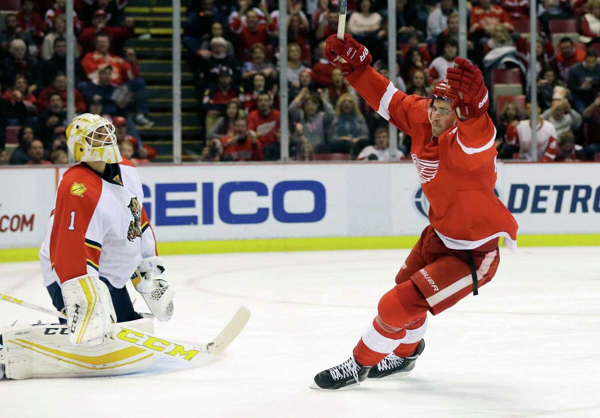 Detroit Red Wings center Dylan Larkin (71) celebrates his goal on Florida Panthers goalie Roberto Luongo (1) during the second period of an NHL hockey game, Sunday, Nov. 29, 2015, in Detroit. (AP Photo/Carlos Osorio) ORG XMIT: MICO107