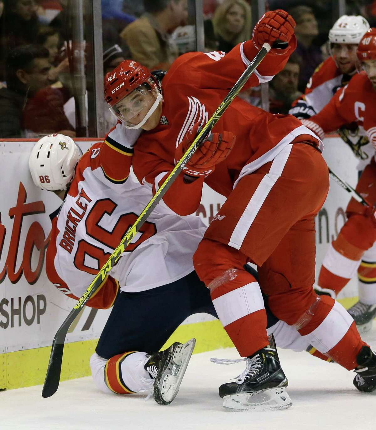 Detroit Red Wings defenseman Alexei Marchenko (47) of Russia checks Florida Panthers center Connor Brickley (86) during the first period of an NHL hockey game, Sunday, Nov. 29, 2015, in Detroit. (AP Photo/Carlos Osorio) ORG XMIT: MICO102