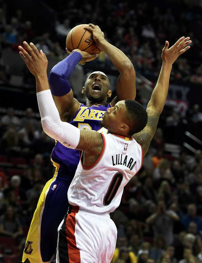 Los Angeles Lakers forward Kobe Bryant (24) shoots the ball over Portland Trail Blazers guard Damian Lillard (0) during the first half of an NBA basketball game on Saturday, Nov. 28, 2015, in Portland, Ore. (AP Photo/Steve Dykes) Photo: STEVE DYKES, Associated Press / FR155163 AP