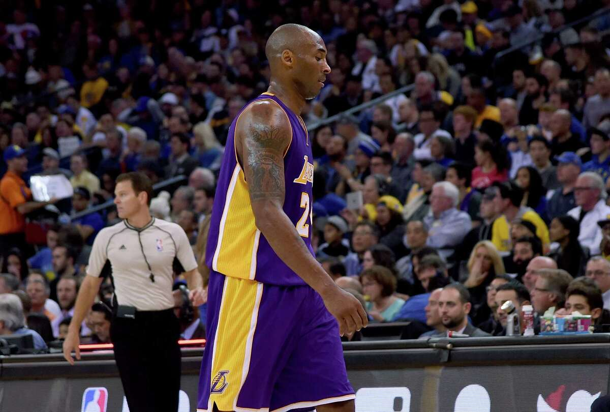 OAKLAND, CA - NOVEMBER 24: Kobe Bryant #24 of the Los Angeles Lakers walks off the court after he was taken out of the game against the Golden State Warriors at ORACLE Arena on November 24, 2015 in Oakland, California. NOTE TO USER: User expressly acknowledges and agrees that, by downloading and or using this photograph, User is consenting to the terms and conditions of the Getty Images License Agreement.