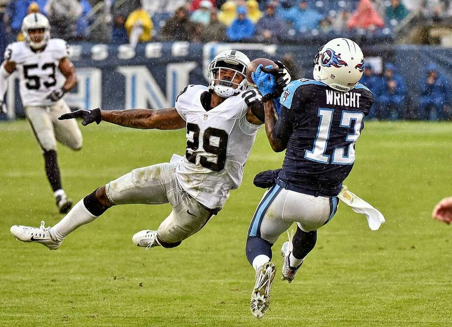 David Amerson knocks the ball away from Kendall Wright. Amerson had six passes defensed and an interception in the game. Photo: Frederick Breedon, Getty Images