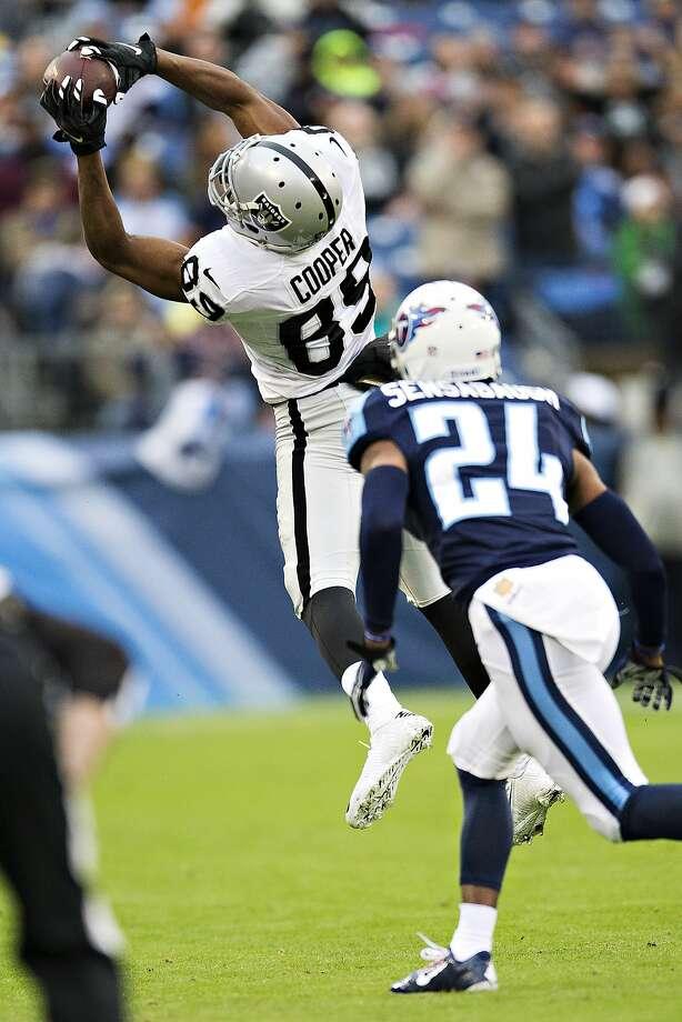 Raiders' Amari Cooper gets plenty of chances to catch ...