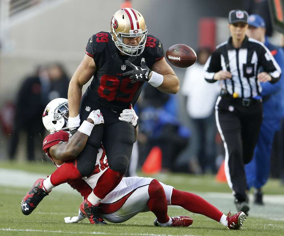 San Francisco 49ers' Vance McDonald fumbles the ball out of bounds while being tackled by Arizona Cardinals' Tony Jefferson in 4th quarter of Arizona's 19-13 win during NFL game at Levi's Stadium in Santa Clara, Calif., on Sunday, November 29, 2015. Photo: Scott Strazzante, The Chronicle