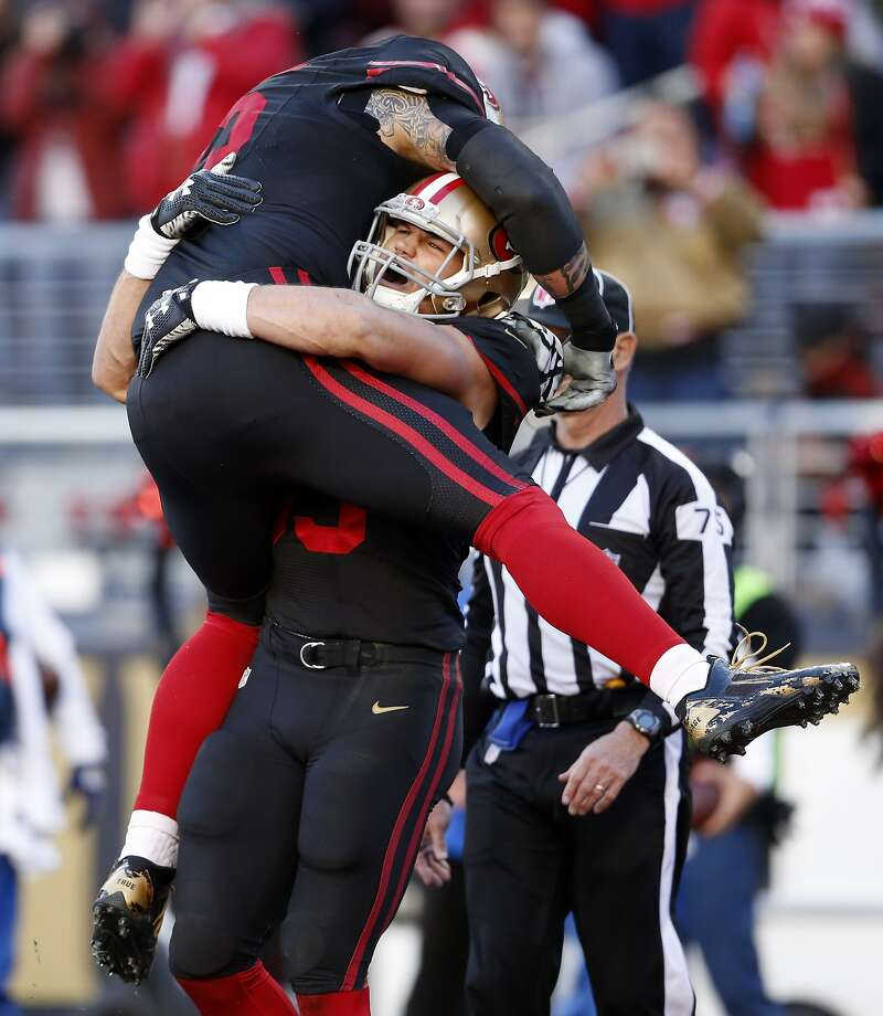 San Francisco 49ers' Vance McDonald hugs Alex Boone after McDonald's 3rd quarter touchdown in 3rd quarter of 19-13 loss to Arizona Cardinals during NFL game at Levi's Stadium in Santa Clara, Calif., on Sunday, November 29, 2015. Photo: Scott Strazzante, The Chronicle