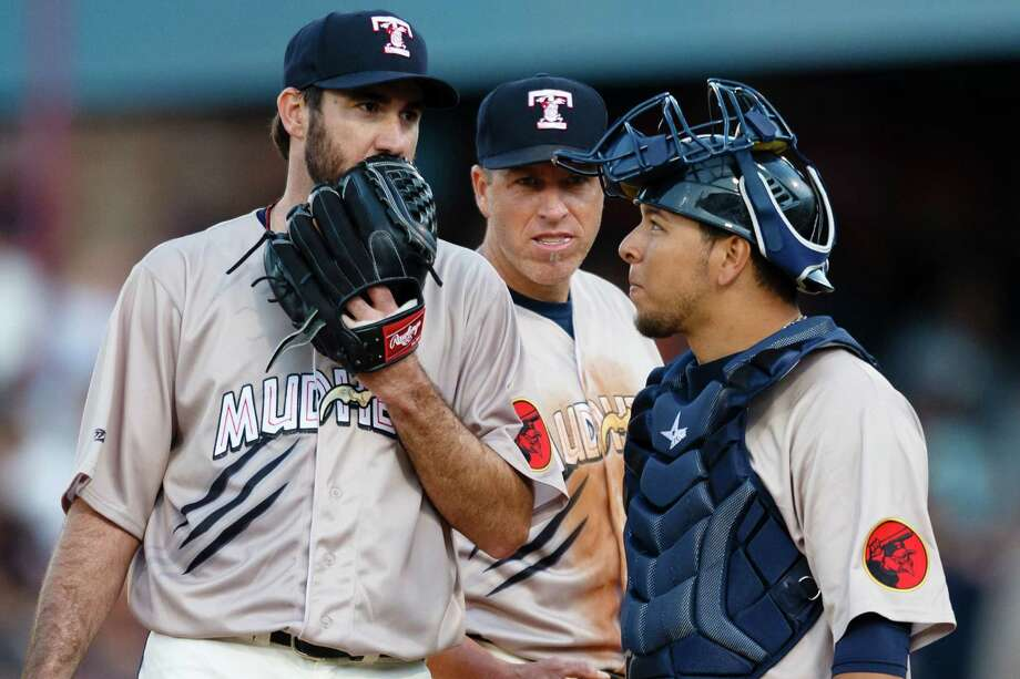 FILE - In this Saturday, June 6, 2015, file photo, Detroit Tigers pitcher Justin Verlander, left, playing for the Toledo Mud Hens in a rehab start, talks to catcher Miguel Gonzalez, right, and first baseman Mike Hessman, center, in the sixth inning during a Triple-A baseball game against the Columbus Clippers in Toledo, Ohio. Hessman became the career home run leader for U.S.-based minor leagues Monday, Aug. 3, 2015, hitting his 433rd in the seventh inning of a game against Lehigh Valley. (AP Photo/Rick Osentoski, File) Photo: Rick Osentoski / AP / FR170444 AP