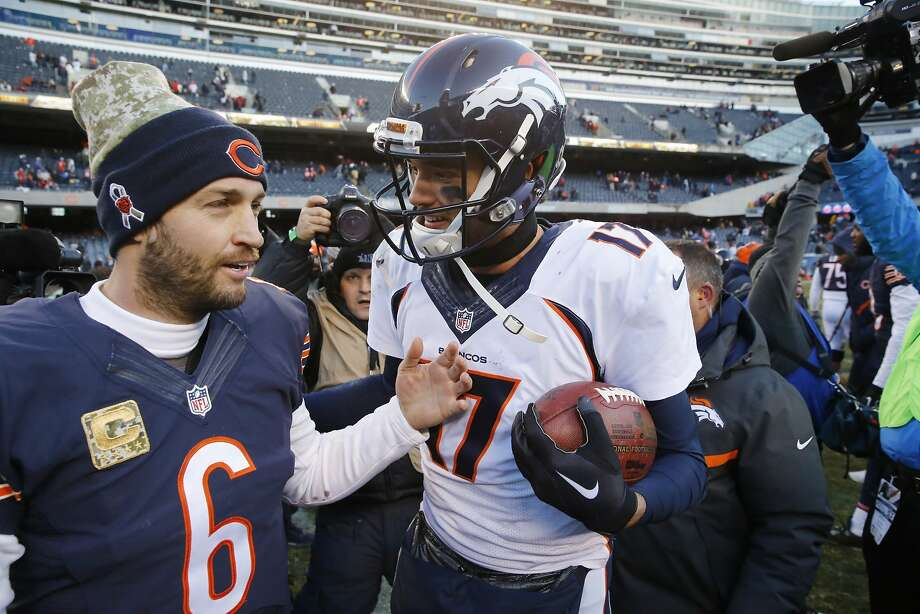 Chicago Bears quarterback Jay Cutler (6) talks to Denver Broncos quarterback Brock Osweiler (17) after an NFL football game, Sunday, Nov. 22, 2015, in Chicago. The Broncos won 17-15. (AP Photo/Charles Rex Arbogast) Photo: Charles Rex Arbogast, Associated Press