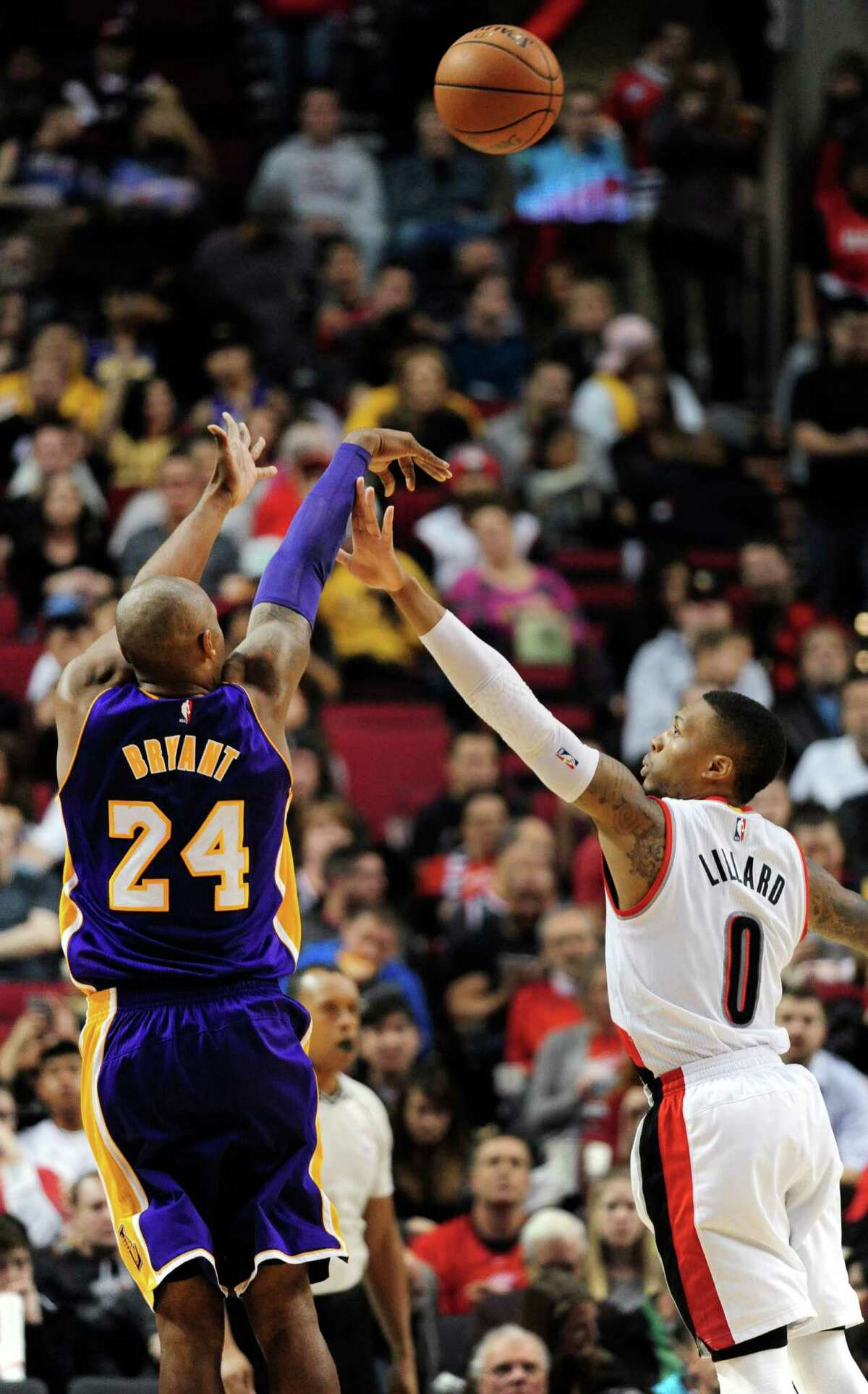 Los Angeles Lakers forward Kobe Bryant (24) shoots over Portland Trail Blazers guard Damian Lillard (0) during the second half of an NBA basketball game Saturday, Nov. 28, 2015, in Portland, Ore. The Blazers won 108-96. (AP Photo/Steve Dykes) ORG XMIT: ORSD113