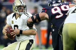 Texans' defense makes it a long, miserable day for Saints QB Drew Brees - Photo