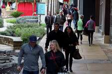 Shoppers meander around The Shops at La Cantera Sunday Nov. 29, 2015.