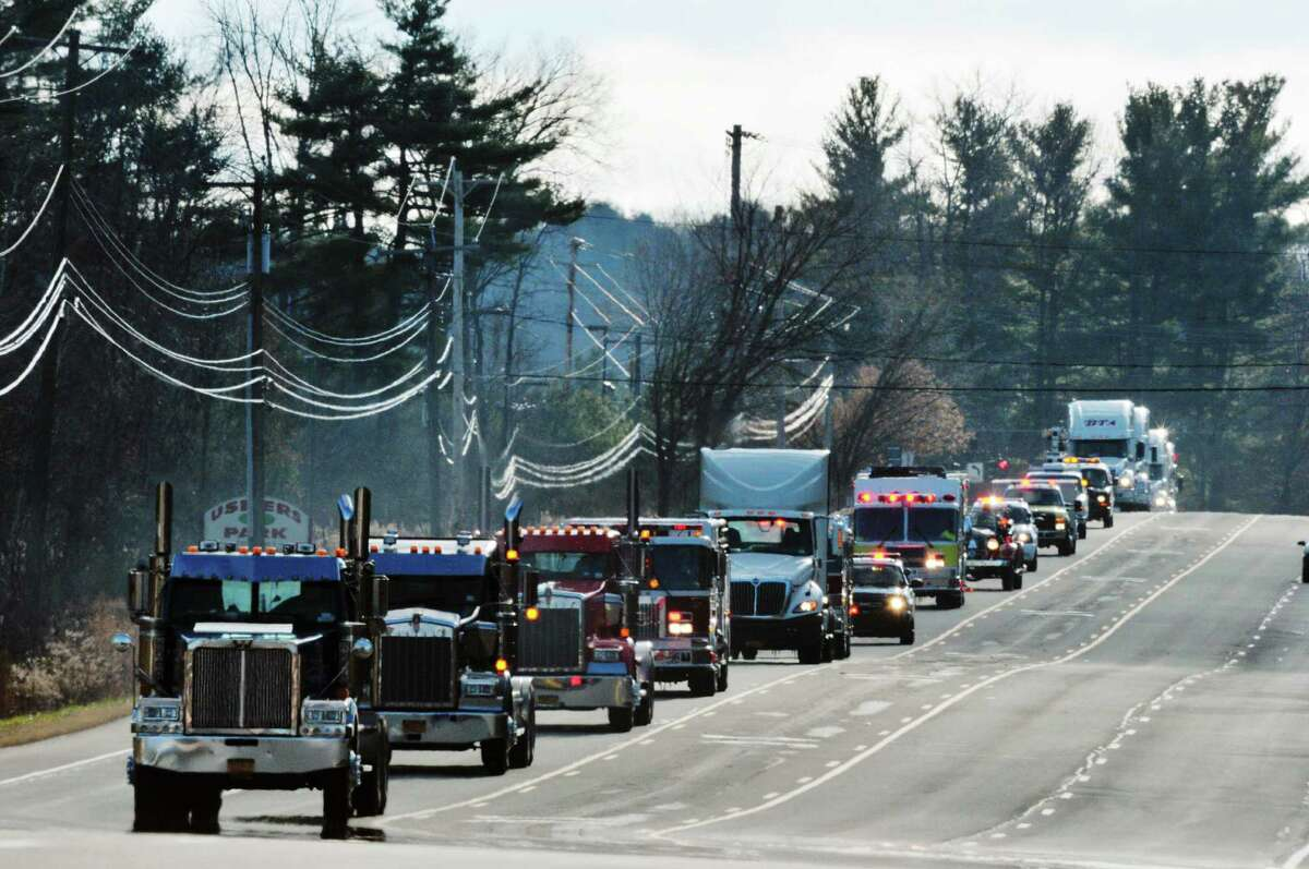 A convoy of emergency vehicles and other trucks heads north on Route 9 as part of the 2015 Convoy for Tots, a Toys for Tots event, on Sunday, Nov. 29, 2015, in Clifton Park, N.Y. The event is held to call attention to the Toys for Tots program and to gather unwrapped toys for needy children. (Paul Buckowski / Times Union)