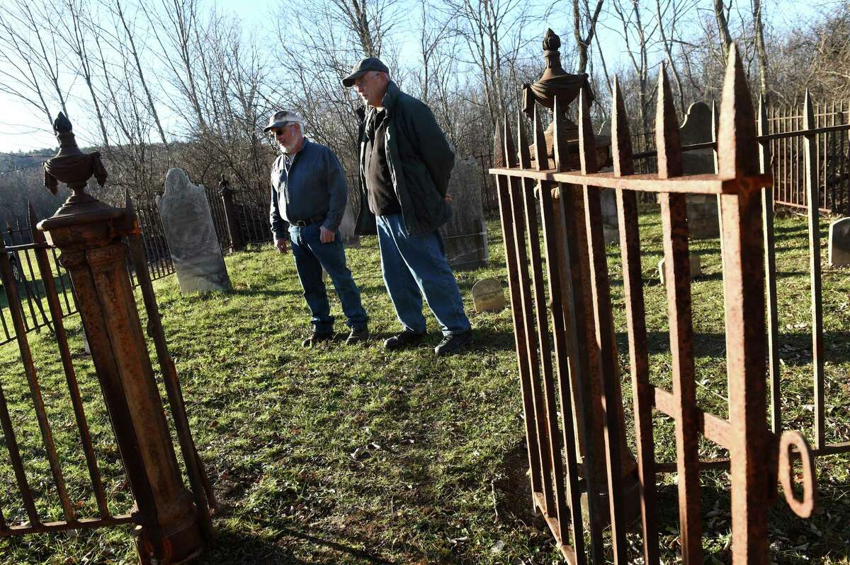 Cemetery hunter Bill Donato, left, and landowner William Bennett stand in the Dunnsville cemetery on Tuesday, Nov. 17, 2015, in Guilderland, N.Y. Donato hunted down the old cemetery, and he repaired it and its wrought iron fence. (Cindy Schultz / Times Union)