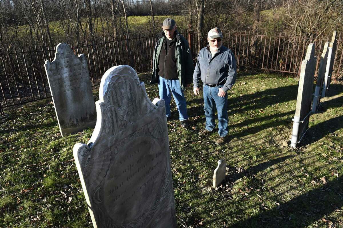 Cemetery hunter Bill Donato, right, and landowner William Bennett stand in the Dunnsville cemetery on Tuesday, Nov. 17, 2015, in Guilderland, N.Y. Donato hunted down the old cemetery, and he repaired it and its wrought iron fence. (Cindy Schultz / Times Union)