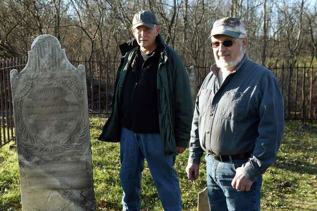 Cemetery hunter Bill Donato, right, and landowner William Bennett stand in the  Dunnsville cemetery on Tuesday, Nov. 17, 2015, in Guilderland, N.Y. Donato hunted down the old cemetery, and he repaired it and its wrought iron fence. (Cindy Schultz / Times Union) Photo: Cindy Schultz / 00034289A