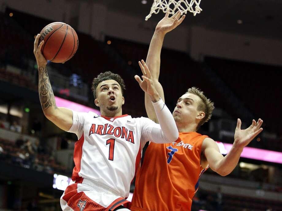 Arizona guard Gabe York drives to the basket against Boise State guard Anthony Drmic. Photo: Jae C. Hong, Associated Press