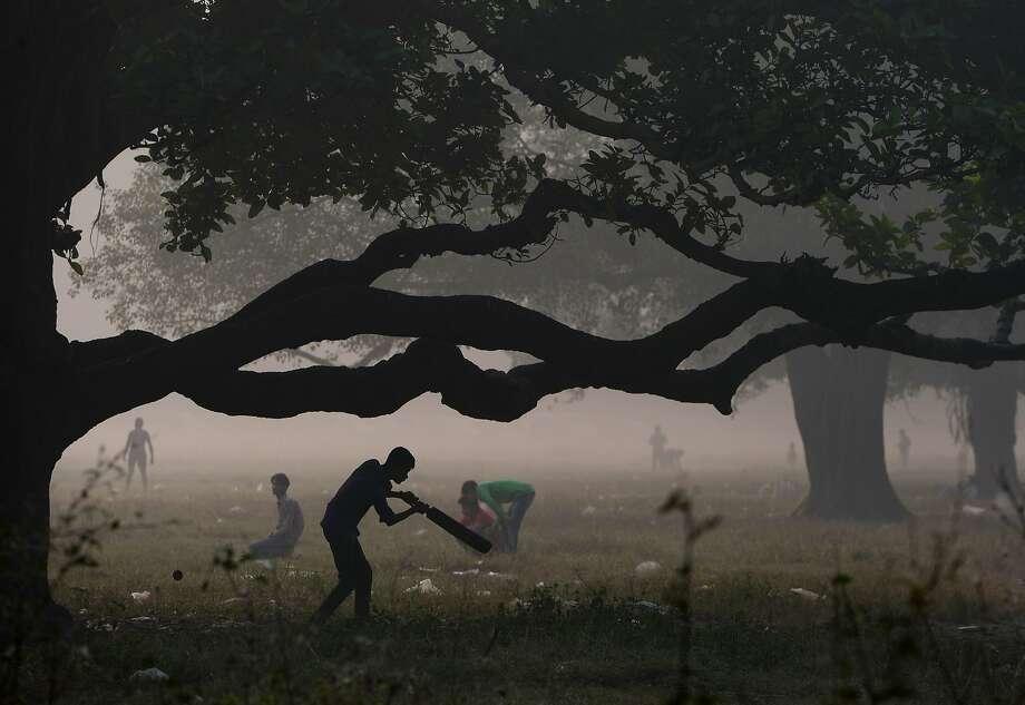 An Indian youth plays cricket in the Maidan area of Kolkata on November 29, 2015. Photo: Dibyangshu Sarkar, AFP / Getty Images