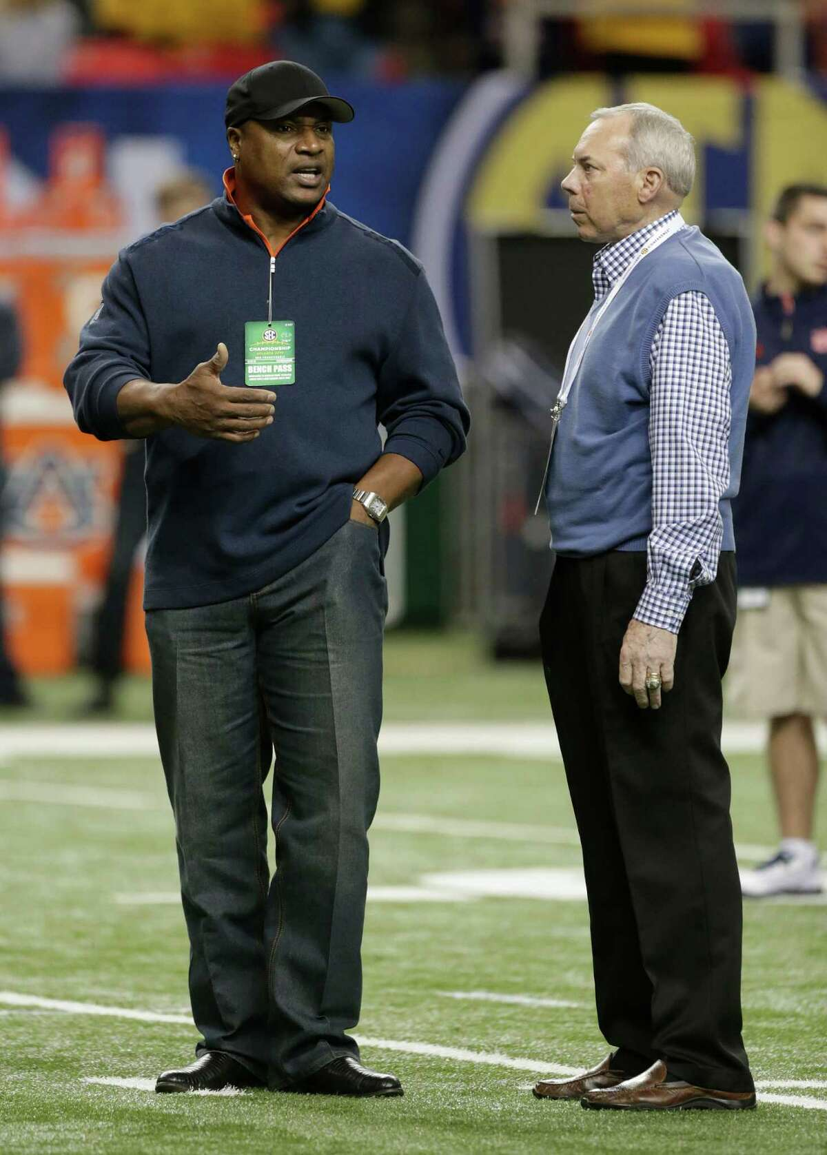 Former Auburn players and Heisman Trophy winners' Bo Jackson, left and Pat Sullivan speak on the field before the first half of the Southeastern Conference NCAA football championship game between the Auburn and the Missouri, Saturday, Dec. 7, 2013, in Atlanta. (AP Photo/Dave Martin) ORG XMIT: GAMS107