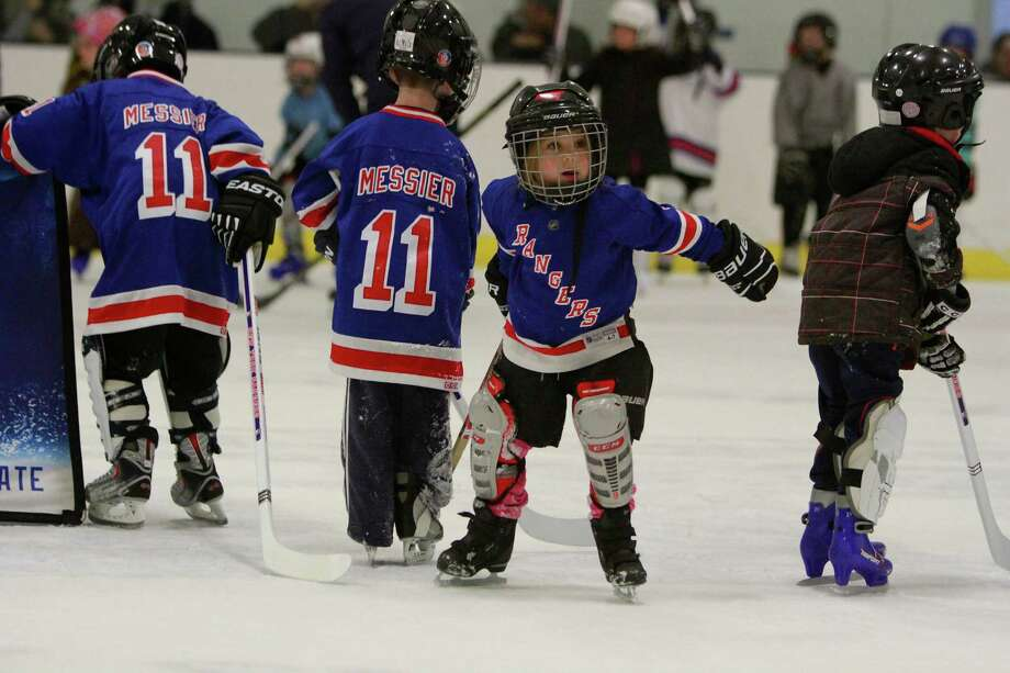 Vita Figaro, 4, of Pound Ridge, New York, second from right, participates with other children during the New York Rangers Try Hockey for Free clinic at Twin Rinks skating facility in Stamford on Nov. 29, 2015.The campaign in its fifth year introduces children ages 4-9 to the sport of hockey. Rangers alumni Adam Graves and John Ogrodnick spent time helping children with their fundamental skills as well as signing autographs after each hour long clinic. Photo: Matthew Brown, For Hearst Connecticut Media / Connecticut Post Freelance