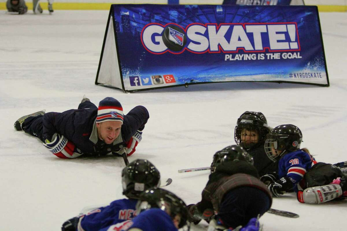 Joe Carfagno works with children during the New York Rangers Try Hockey for Free clinic at Twin Rinks skating facility in Stamford on Nov. 29, 2015.The campaign in its fifth year introduces children ages 4-9 to the sport of hockey. Rangers alumni Adam Graves and John Ogrodnick spent time helping children with their fundamental skills as well as signing autographs after each hour long clinic.