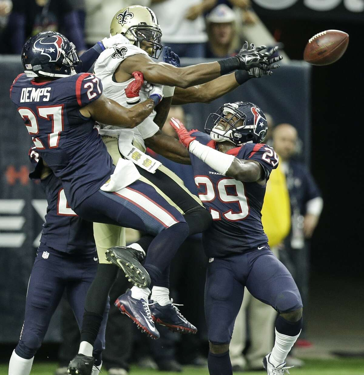 Houston Texans defensive backs Quintin Demps (27) and Andre Hal (29) break up a pass in the end zone intended for New Orleans Saints wide receiver Brandon Coleman (16) during the fourth quarter of an NFL football game at NRG Stadium on Sunday, Nov. 29, 2015, in Houston. ( Brett Coomer / Houston Chronicle )