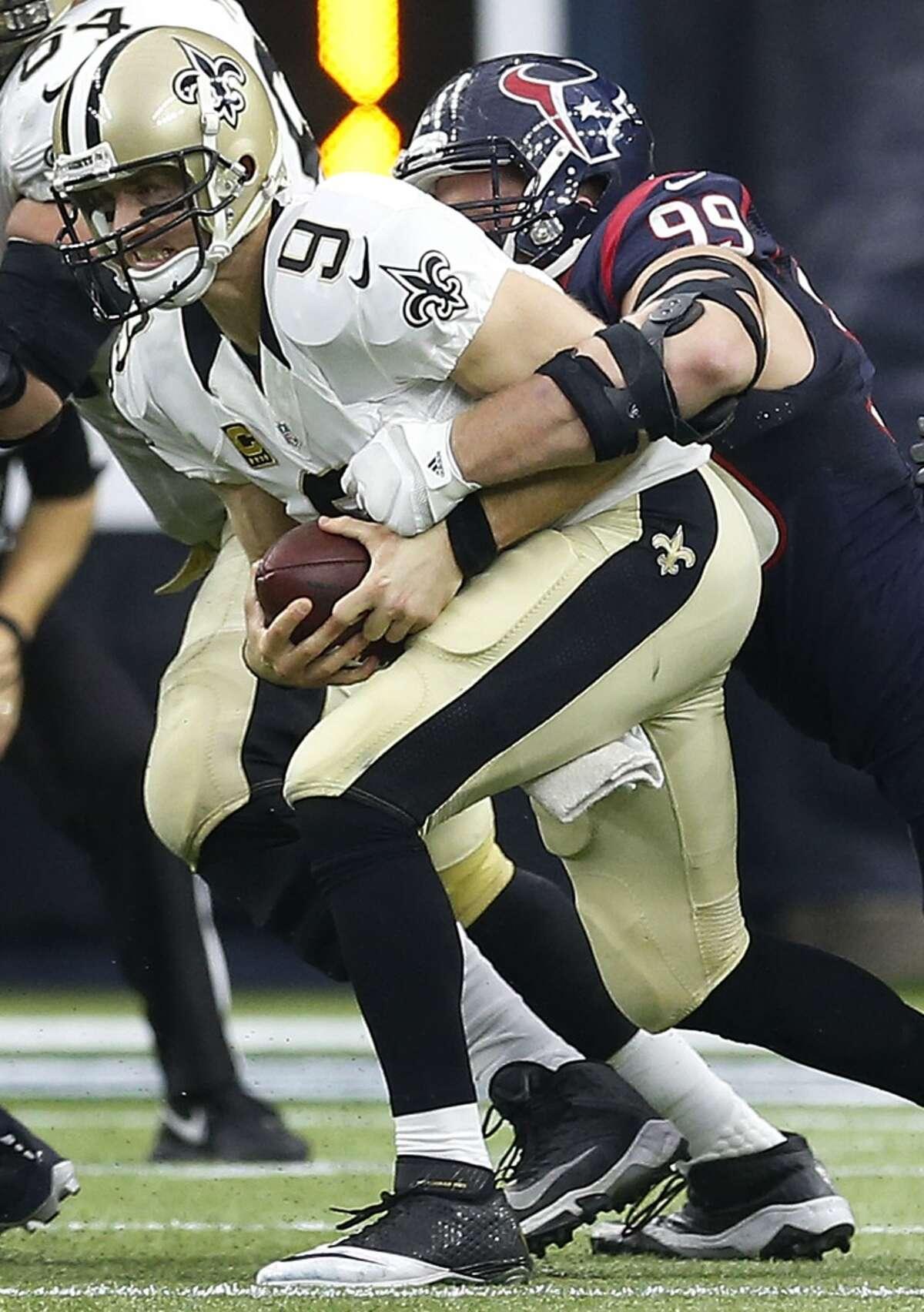 Houston Texans defensive end J.J. Watt (99) sacks New Orleans Saints quarterback Drew Brees (9) in the third quarter of an NFL football game at NRG Stadium on Sunday, Nov. 29, 2015, in Houston. ( Karen Warren / Houston Chronicle )