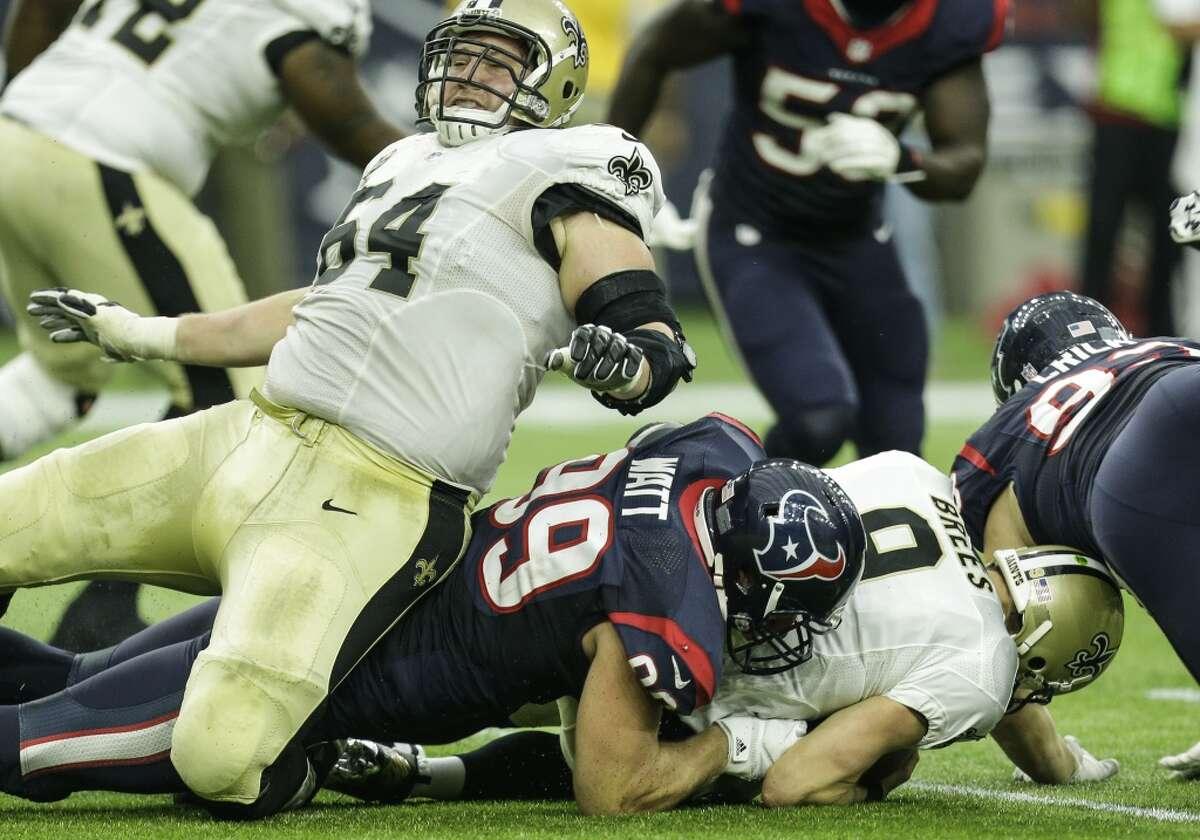 Houston Texans defensive end J.J. Watt (99) beats New Orleans Saints tackle Zach Strief (64) to sack quarterback Drew Brees (9) during the third quarter of an NFL football game at NRG Stadium on Sunday, Nov. 29, 2015, in Houston. ( Brett Coomer / Houston Chronicle )