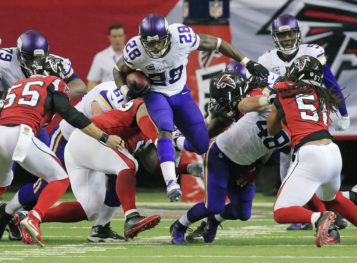 Minnesota Vikings running back Adrian Peterson goes over the top and breaks free for yardage against the Atlanta Falcons during the second half of an NFL football game on Sunday, Nov. 29, 2015, in Atlanta. The Vikings defeated the Falcons 20-10. (Curtis Compton/Atlanta-Journal Constitution via AP) MARIETTA DAILY OUT, GWINNETT DAILY POST OUT, LOCAL TV OUT (WXIA, WGCL, FOX 5) ORG XMIT: GAATJ208