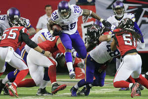 Peterson, Vikings foil Falcons - Photo