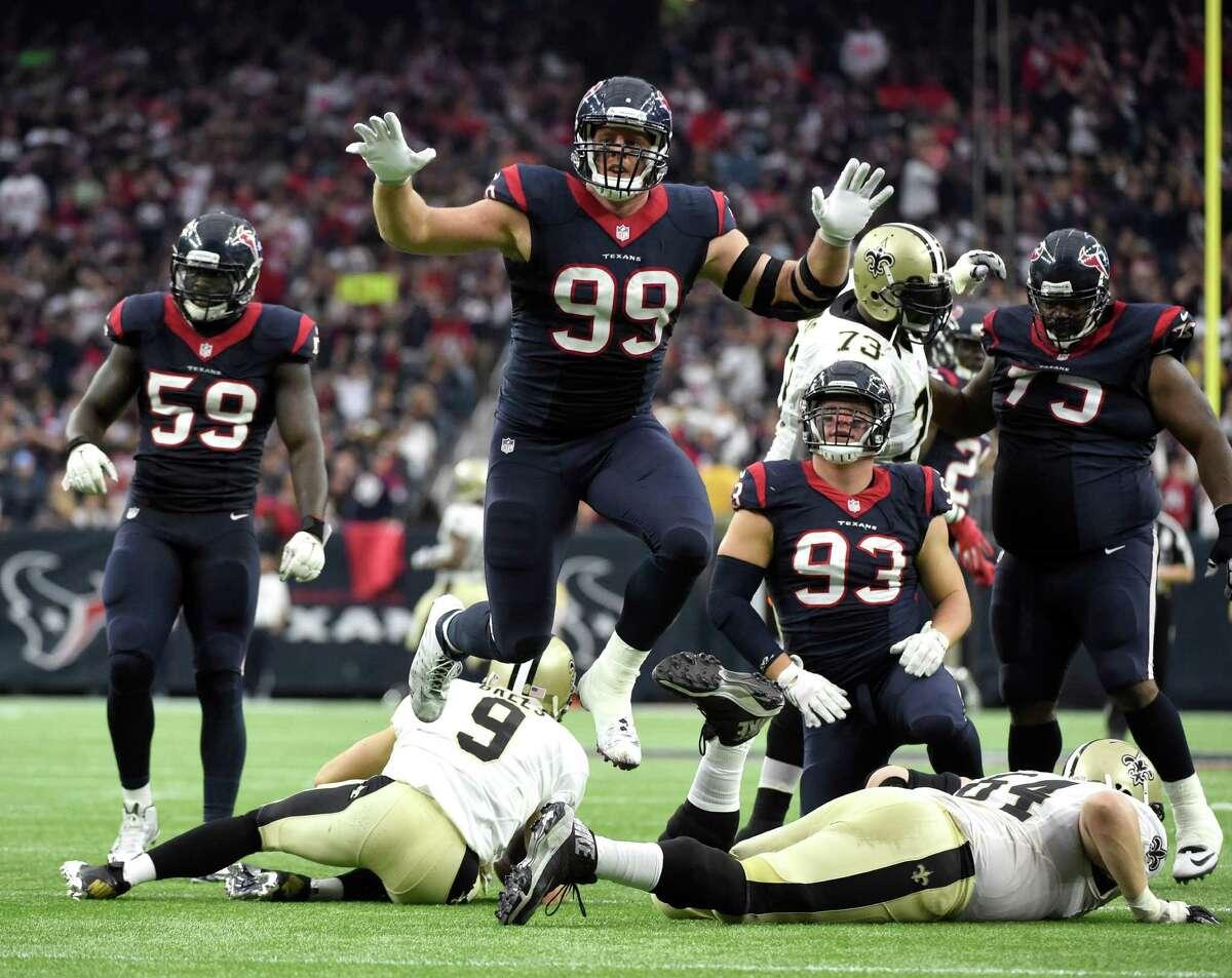 Houston Texans defensive end J.J. Watt (99) leaps after sacking New Orleans Saints quarterback Drew Brees (9) during the third quarter of an NFL football game, Sunday, Nov. 29, 2015, in Houston. (AP Photo/Eric Christian Smith) ORG XMIT: TXDP122