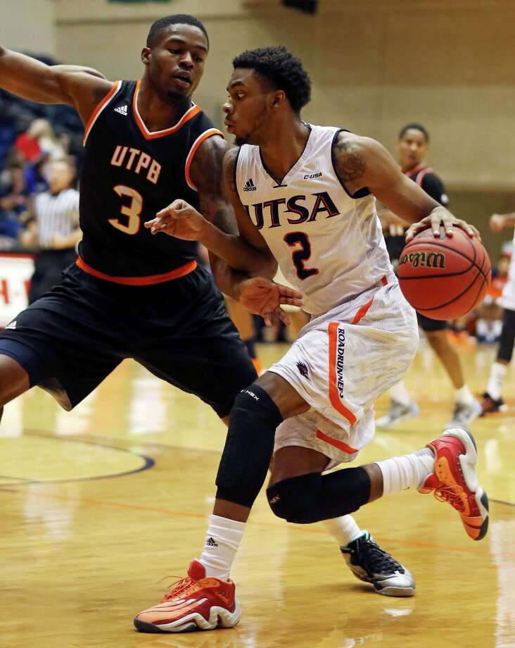 UTSA's J.R. Harris looks for room around  UT Permian Basin's Billy Dee Willimas during first half action Sunday Nov. 29, 2015 at the Convocation Center. Photo: Edward A. Ornelas, Staff / San Antonio Express-News / © 2015 San Antonio Express-News