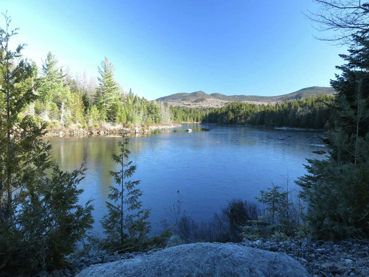 this photo taken on Tuesday, Nov. 17, 2015, shows LaBiere Flow, a dammed stretch of the Boreas River, viewed from a logging road in the Boreas Pond tract in North Hudson, N.Y. Gov. Andrew Cuomo has committed to purchasing the 22,000-acre Boreas Pond tract from The Nature Conservancy by the end of March, completing the acquisition of 69,000 acres of former Finch, Pruyn timber company lands to expand the state?'s constitutionally protected Forest Preserve. (AP Photo/Mary Esch) ORG XMIT: RPME203