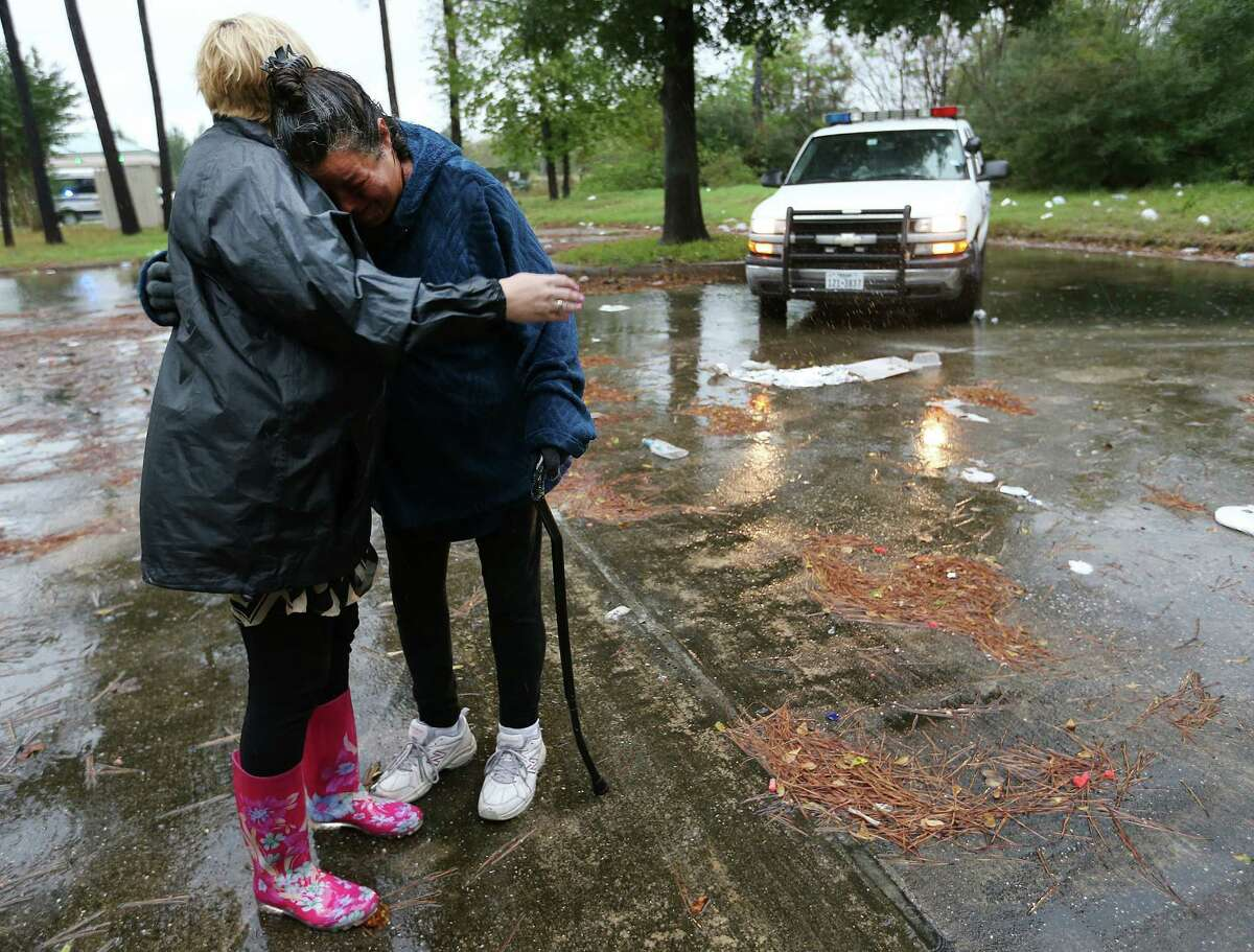 Kristyn Stillwell, left, of Champions 4 Hope, hugs Jennifer Allen as Stillwell works with the Harris County Sheriff's Office's homeless outreach team last month.