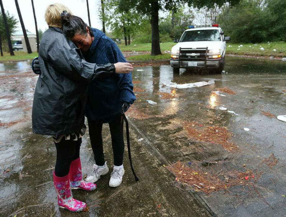 Kristyn Stillwell, left, of Champions 4 Hope, hugs Jennifer Allen as Stillwell works with the Harris County Sheriff's Office's homeless outreach team last month. Photo: Elizabeth Conley, Staff / © 2015 Houston Chronicle