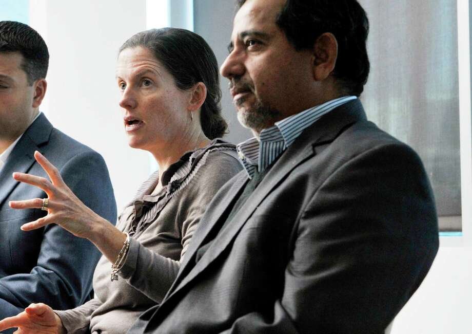 Catherine Gilbert, left, vice president of SUNY Poly Children's Museum of Science and Technology, center, with Pradeep Haldar back in 2015 before Haldar sued the school. (Paul Buckowski / Times Union) Photo: PAUL BUCKOWSKI / 00034136A