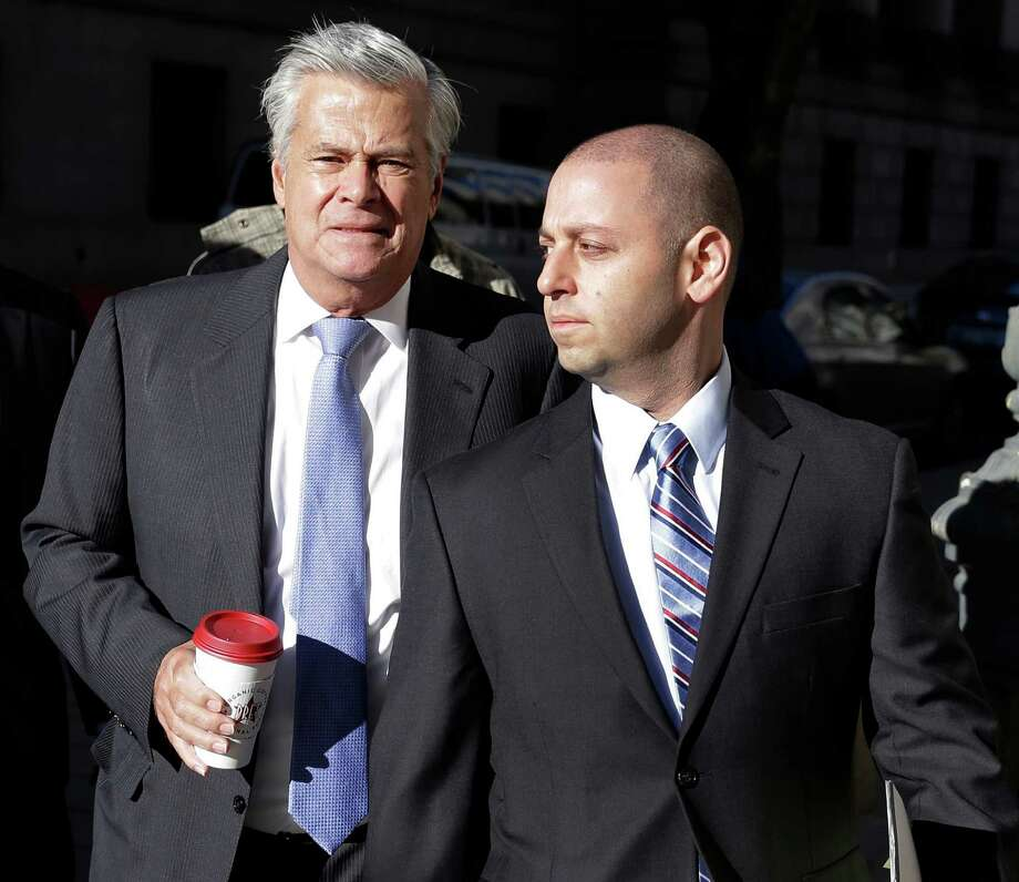 New York Sen. Dean Skelos, left, and his son Adam Skelos arrive to court in New York, Tuesday, Nov. 17, 2015. Jury selection is expected to continue Tuesday in the corruption trial of Dean Skelos, who is facing federal charges that he extorted bribes from companies with business before the state. (AP Photo/Seth Wenig) ORG XMIT: NYSW102 Photo: Seth Wenig / AP